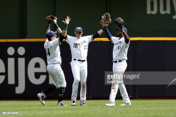 Hernan Perez Christian Yelich and Domingo Santana of the Milwaukee Brewers celebrate after beating the Arizona Diamondbacks 92 at Miller Park on May...