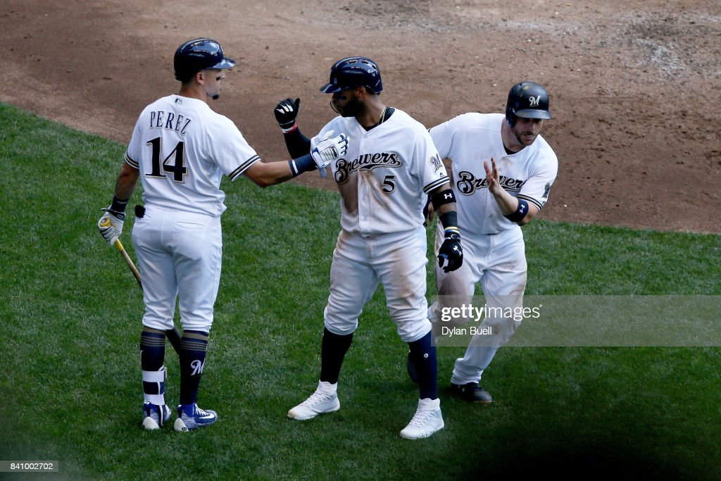 Hernan Perez #14, Jonathan Villar #5, Stephen Vogt #12 of the Milwaukee Brewers celebrate after Villar hit a home run in the sixth inning against the St. Louis Cardinals at Miller Park on August 30, 2017 in Milwaukee, Wisconsin.