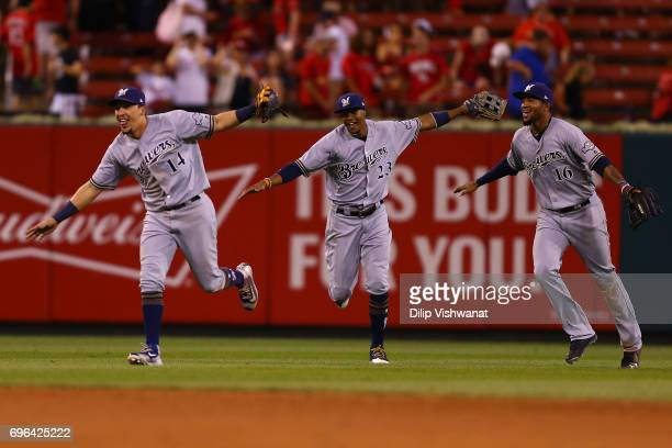 Hernan Perez Keon Broxton and Domingo Santana of the Milwaukee Brewers celebrate after beating the St Louis Cardinals at Busch Stadium on June 15...