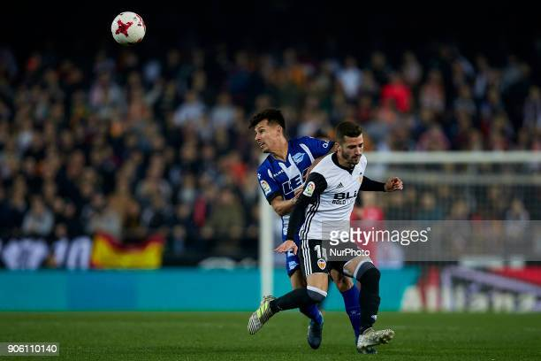 Hernan Perez of Deportivo Alaves competes for the ball with Jose Luis Gaya of Valencia CF during the Copa del Rey quarterfinal first leg game between...
