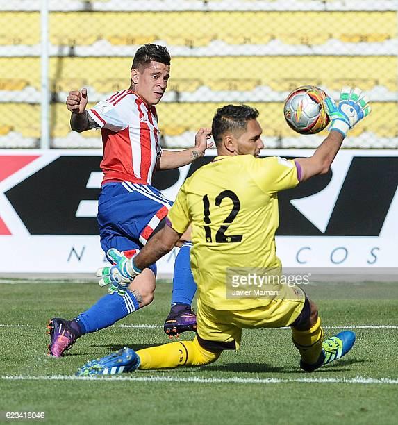 Hernan Perez of Paraguay kicks the ball as Daniel Vaca goalkeeper of Bolivia defends during a match between Bolivia and Paraguay as part of FIFA 2018...