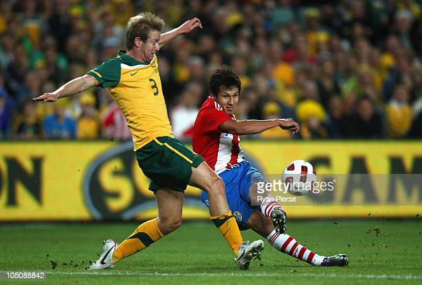 Hernan Perez of Paraguay shoots past David Carney of Australia during the friendly match between the Australian Socceroos and Paraguay at the Sydney...