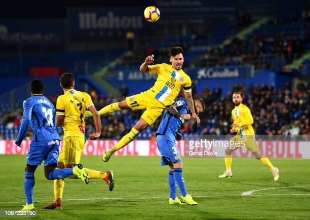 Hernan Perez of RCD Espanyol competes for a header with Vitorino Antunes of Getafe during the La Liga match between Getafe CF and RCD Espanyol at...