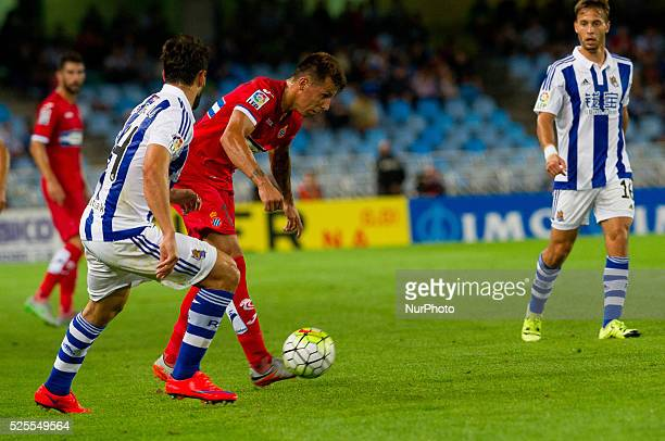 Hernan Perez of RCD Espanyol duels for the ball with De la Bella of Real Sociedad during the Spanish league football match Real Sociedad vs RCD...