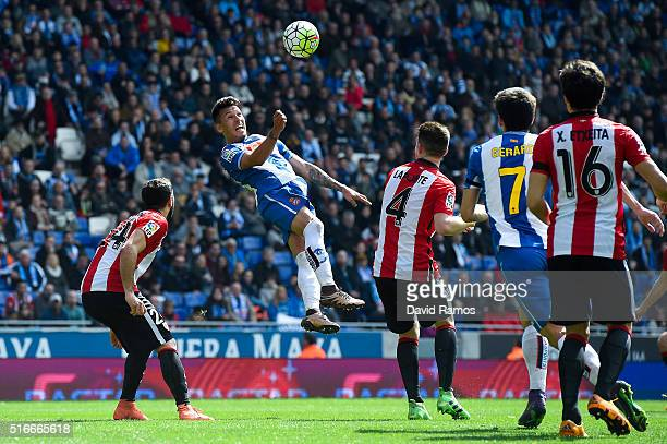 Hernan Perez of RCD Espanyol heads the ball past Inigo Lekue of Athletic de Bilbao during the La Lga match between Real CD Espanyol and Athletic Club...