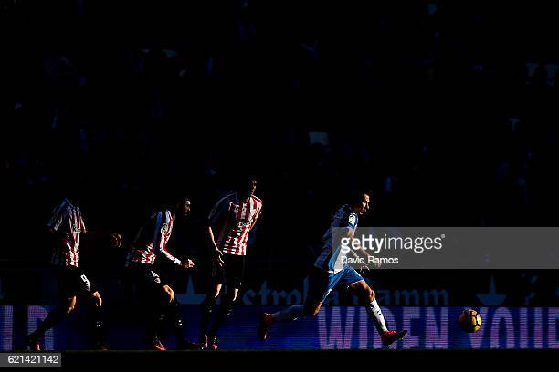 Hernan Perez of RCD Espanyol is chased by Athletic Bilbao players during the La Liga match between RCD Espanyol and Athletic Bilbao at CornellaEl...