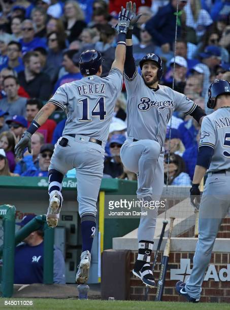 Hernan Perez of the Milwaukee Brewers celebrates his a two run home run in the 5th inning with teammate Ryan Braun against the Chicago Cubs at...