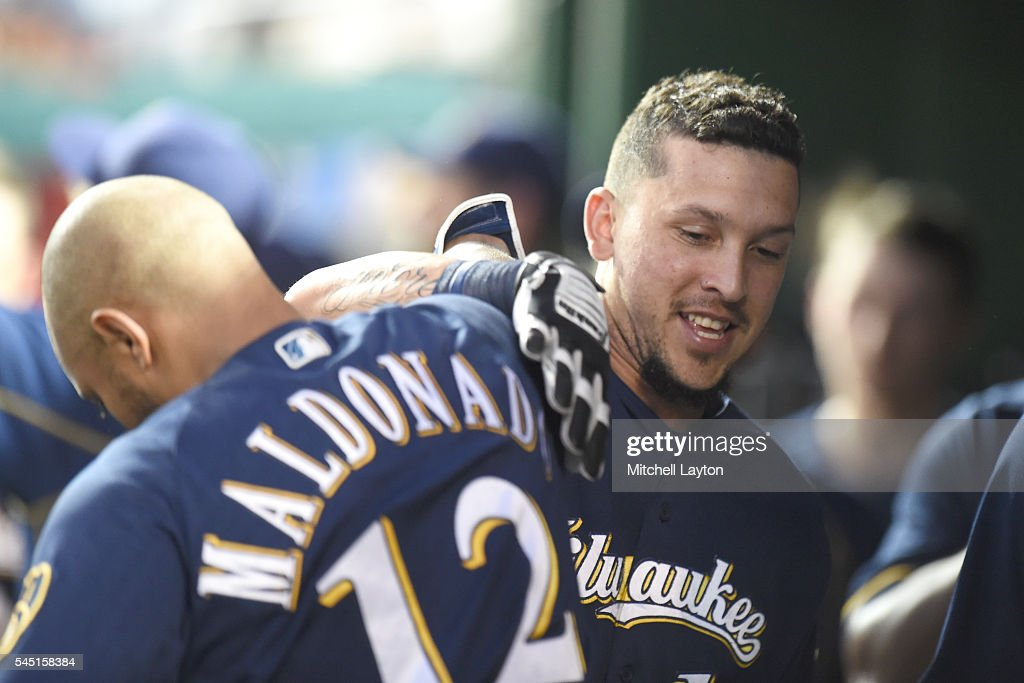 Hernan Perez #14 of the Milwaukee Brewers celebratres with Martin Maldonado #12 after hitting a two run home run in the sixth inning during a baseball game against the Washington Nationals at Nationals Park on July 5, 2016 in Washington, DC.