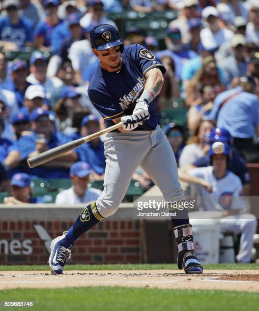 Hernan Perez of the Milwaukee Brewers hits a run scoring single in the 1st inning against the Chicago Cubs at Wrigley Field on July 6 2017 in Chicago...