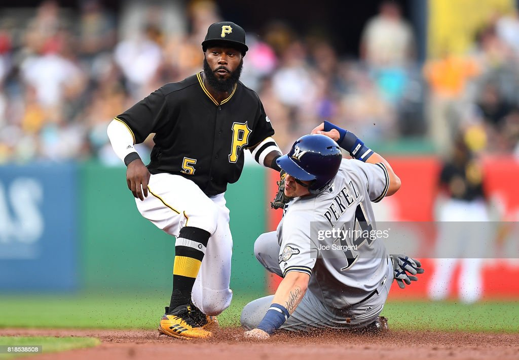 Hernan Perez #14 of the Milwaukee Brewers is caught stealing by Josh Harrison #5 of the Pittsburgh Pirates during the third inning at PNC Park on July 18, 2017 in Pittsburgh, Pennsylvania.