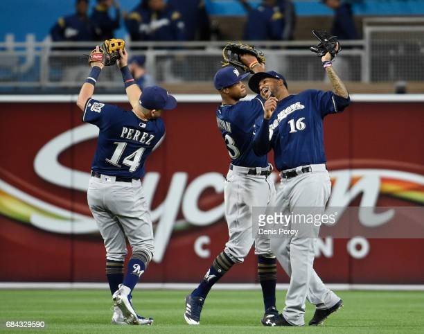 Hernan Perez of the Milwaukee Brewers Keon Broxton and Domingo Santana celebrate after beating the San Diego Padres 31 in a baseball game at PETCO...