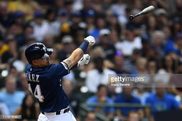 Hernan Perez of the Milwaukee Brewers loses his bat during the third inning against the San Diego Padres at Miller Park on September 19 2019 in...