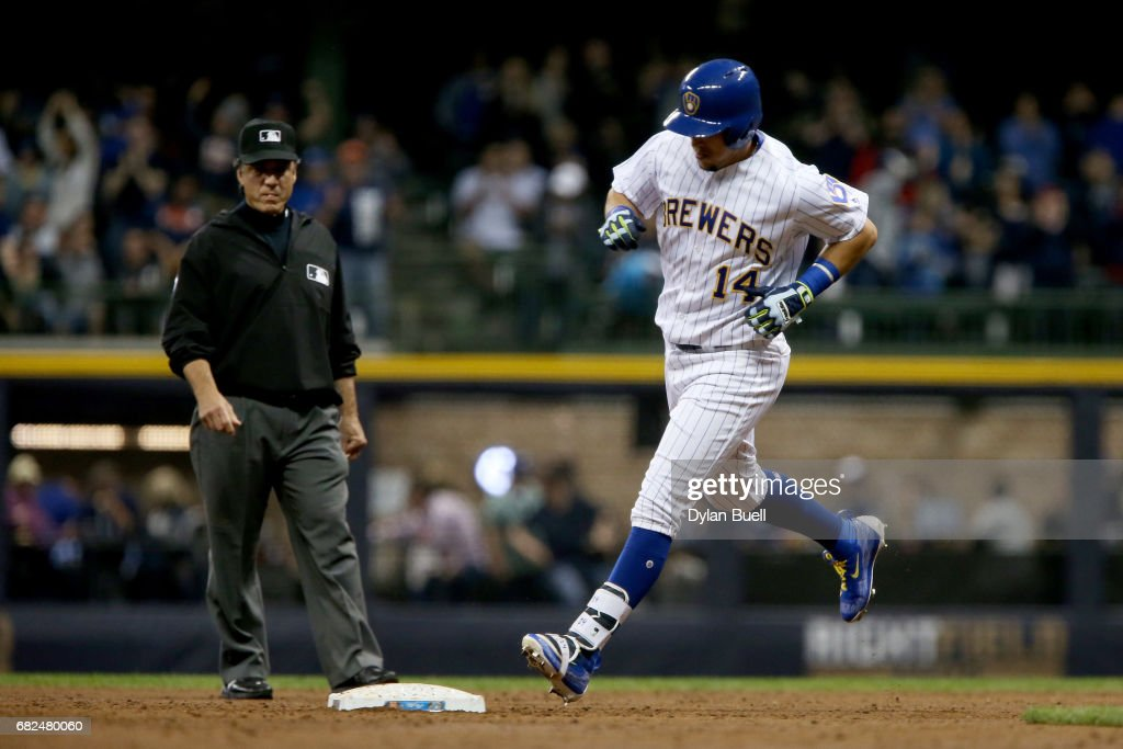 Hernan Perez #14 of the Milwaukee Brewers rounds the bases after hitting a home run in the third inning against the New York Mets at Miller Park on May 12, 2017 in Milwaukee, Wisconsin.