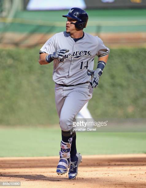 Hernan Perez of the Milwaukee Brewers runs the bases after hitting a two run home run in the 5th inning against the Chicago Cubs at Wrigley Field on...