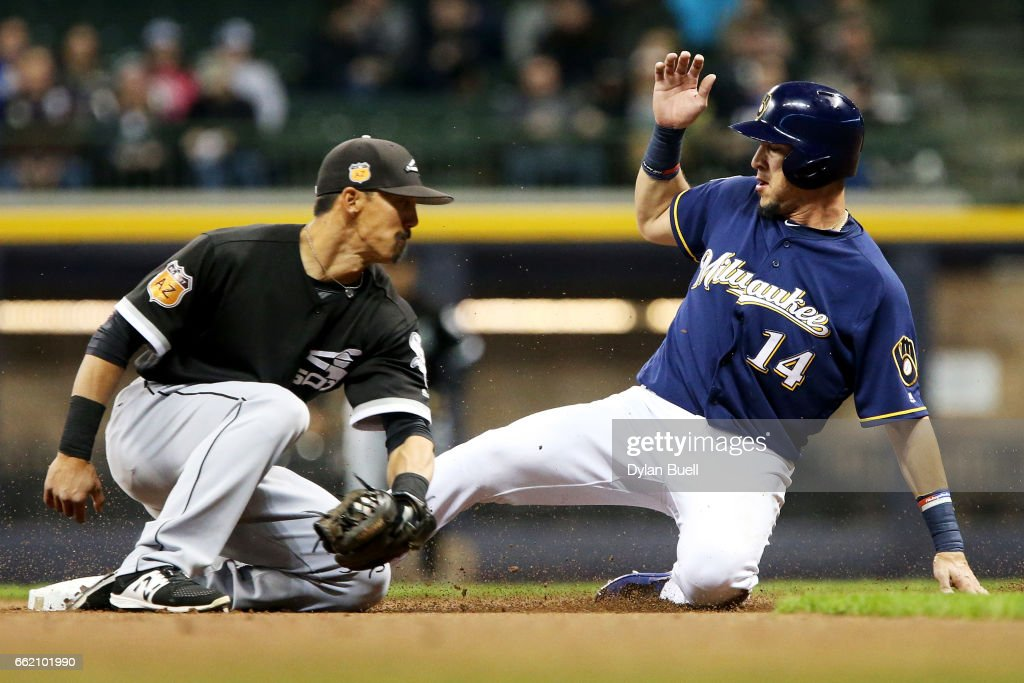 Hernan Perez #14 of the Milwaukee Brewers steals second base past Tyler Saladino #20 of the Chicago White Sox in the first inning during an exhibition game at Miller Park on March 31, 2017 in Milwaukee, Wisconsin.