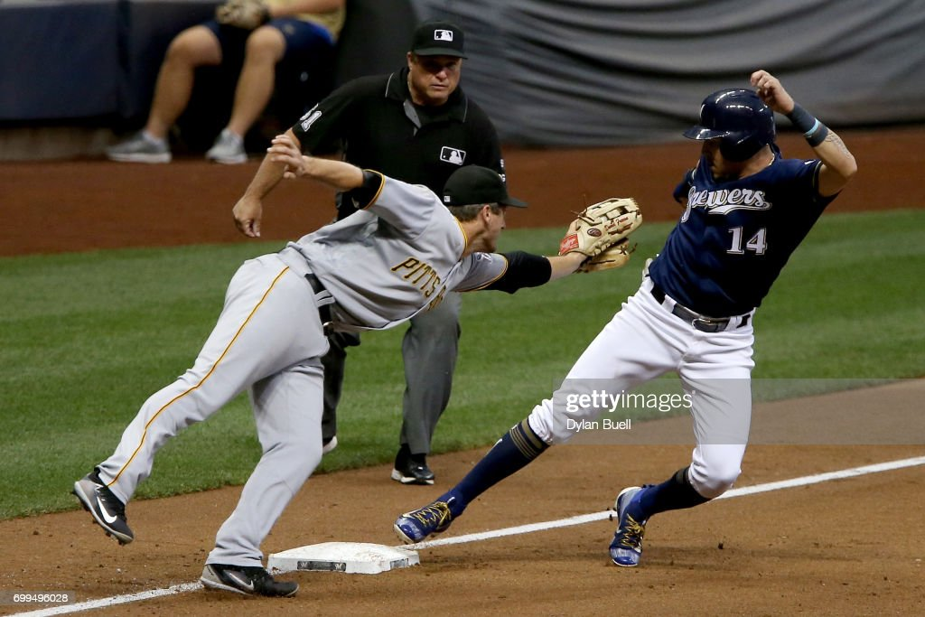 Hernan Perez #14 of the Milwaukee Brewers steals third base past David Freese #23 of the Pittsburgh Pirates in the fourth inning at Miller Park on June 21, 2017 in Milwaukee, Wisconsin.