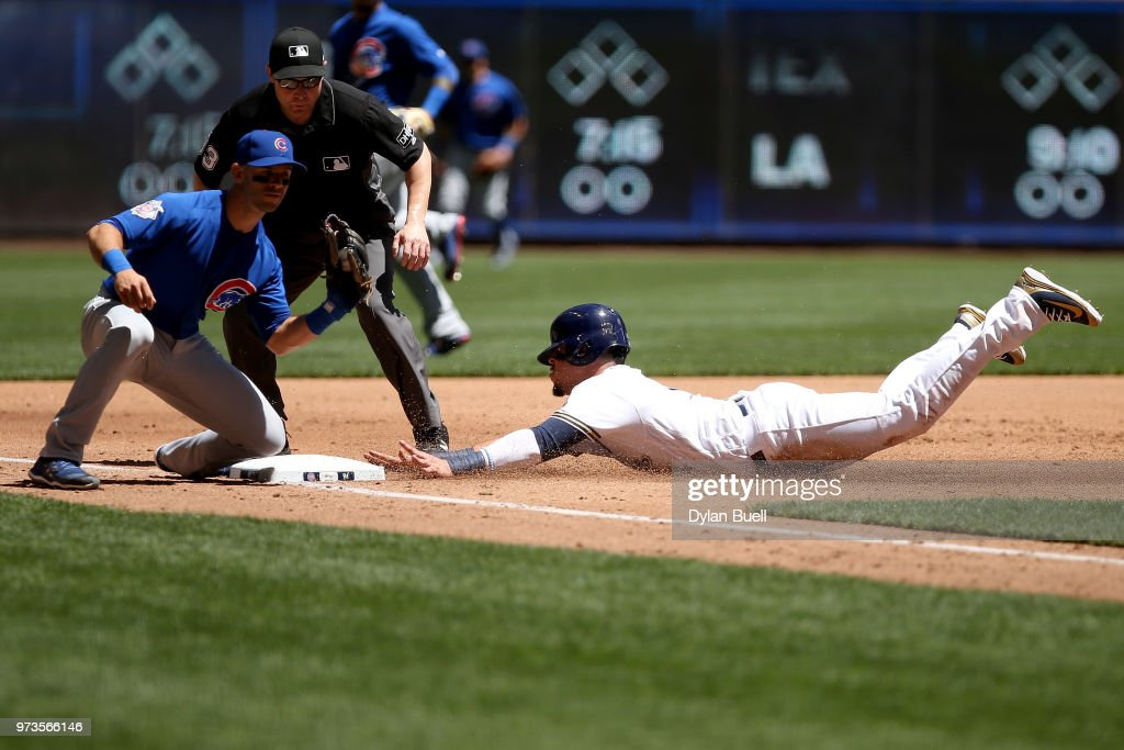 Hernan Perez #14 of the Milwaukee Brewers steals third base past Tommy La Stella #2 of the Chicago Cubs in the second inning at Miller Park on May 27, 2018 in Milwaukee, Wisconsin.