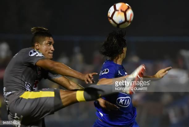 Hernan Pertuz of Colombias Independiente de Medellin vies for the ball with Pablo Zeballos of Paraguay's Sol de America during their 2018 Copa...