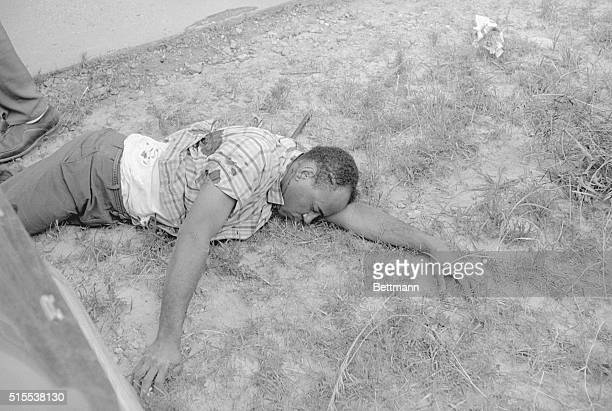 James Meredith with blood streaming from his wounds lies beside Mississippi Highway 51 after he was shot from ambush June 6 A Memphis man Aubrey J...