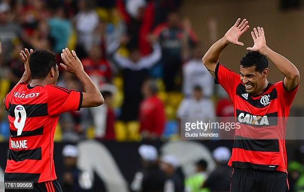 Hernane and Andre Santos of Flamengo celebrate a scored goal during a match between Fluminense and Flamengo as part of Brazilian Championship 2013 at...