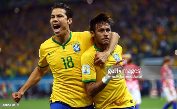 Hernanes and Neymar of Brazil celebrat scoring his second goal on a penalty kick in the second half during the 2014 FIFA World Cup Brazil Group A...