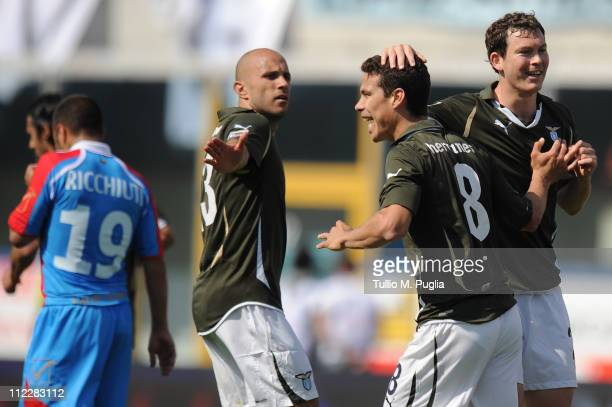 Hernanes of Lazio celebrates with teeammates after scoring the opening goal of the Serie A match between Catania Calcio and SS Lazio at Stadio Angelo...