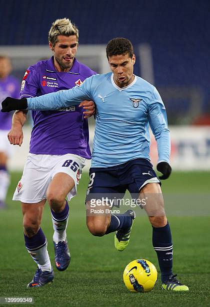 Hernanes of SS Lazio competes for the ball with Valon Behrami of ACF Fiorentina during the Serie A match between SS Lazio and ACF Fiorentina at...