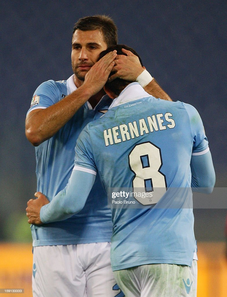 Hernanes (R) of SS Lazio is congratulated by team-mate Lorik Cana after scoring their team's third goal during the TIM Cup match between S.S. Lazio and Calcio Catania at Stadio Olimpico on January 8, 2013 in Rome, Italy.