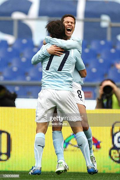 Hernanes with his teammate Giuseppe Sculli of SS Lazio celebrates after scoring the opening goal during the Serie A match between SS Lazio and AS...