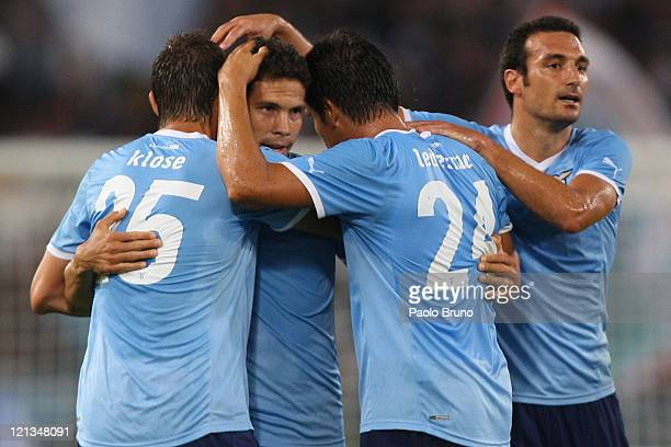 Hernanes with his teammates of SS Lazio celebrates after scoring the opening goal during the UEFA Europa League playoff first leg match between SS...