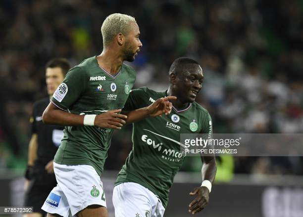 Hernani Azevedo Junior celebrates with teammate Senegalese midfielder Assane Diousse after scoring during the French L1 football match between AS...