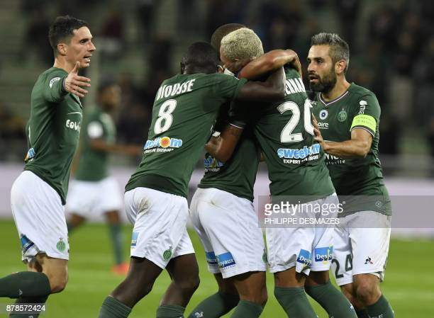 Hernani Azevedo Junior celebrates with teammates after scoring during the French L1 football match between AS SaintEtienne and RC Strasbourg at The...
