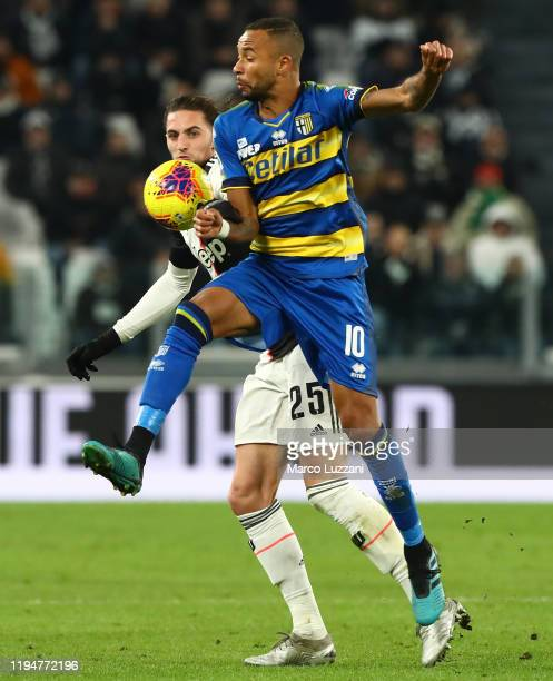 Hernani Jr of Parma Calcio competes for the ball with Adrien Rabiot of Juventus FC during the Serie A match between Juventus and Parma Calcio at...