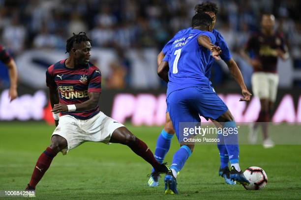 Hernani of FC Porto competes for the ball with Christian Atsu of Newcastle during the preseason friendly match between FC Porto and Newcastle at...