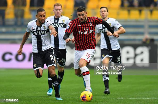 Hernani of Parma Calcio competes for the ball with Theo Hernandez of AC Milan during the Serie A match between Parma Calcio and AC Milan at Stadio...
