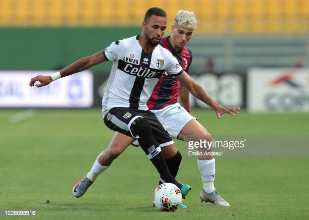 Hernani of Parma Calcio is challenged by Nicolas Dominguez of Bologna FC during the Serie A match between Parma Calcio and Bologna FC at Stadio Ennio...