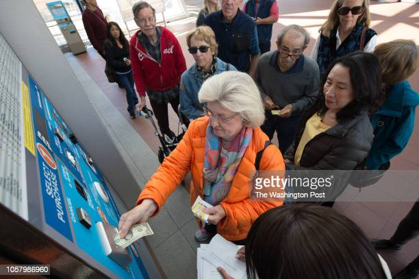Herndon resident Nancy Como adds fare to her new Senior SmarTrip card in the WiehleReston East Metro station during a handson learning session on the...