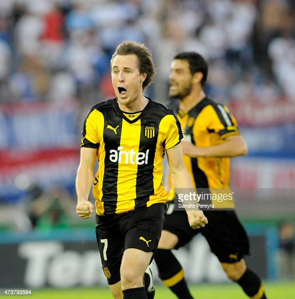 Hernán Novick of Peñarol celebrates after scoring his team's first goal during a match between Peñarol and Nacional as part of 12th round of Torneo...