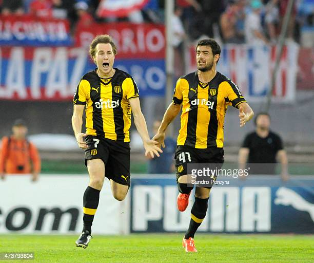 Hernán Novick of Peñarol celebrates with Luis Aguiar celebrates after scoring his team's first goal during a match between Peñarol and Nacional as...