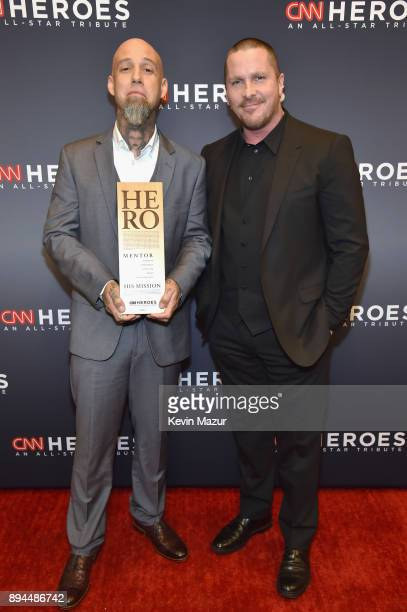Hero Aaron Valencia and Christian Bale pose during CNN Heroes 2017 at the American Museum of Natural History on December 17 2017 in New York City...