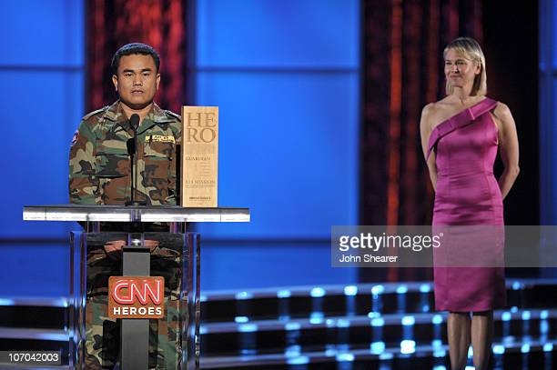 Hero Aki Ra of �Cambodian Self Help Demining� and Presenter Renee Zellweger onstage during the 2010 CNN Heroes: An All-Star Tribute held at The...
