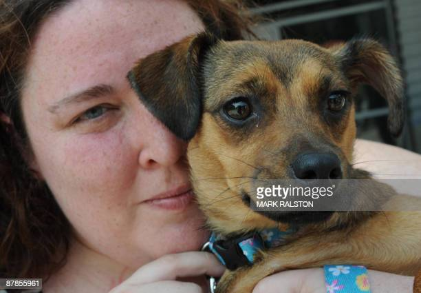 """Hero Dog """"Miley"""" is cuddled by owner Stacie Pitts after receiving the 27th Annual National Hero Dog Award for saving Pitts from carbon monoxide..."""