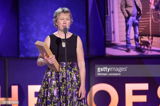Hero Ellen Stackable accepts an award onstage during the 12th Annual CNN Heroes An AllStar Tribute at American Museum of Natural History on December...