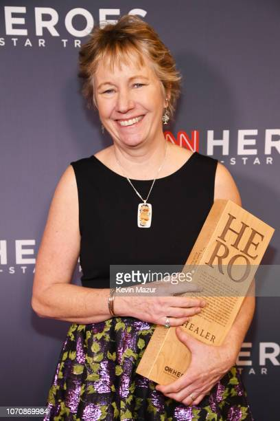 Hero Ellen Stackable poses with her award during the 12th Annual CNN Heroes An AllStar Tribute at American Museum of Natural History on December 9...