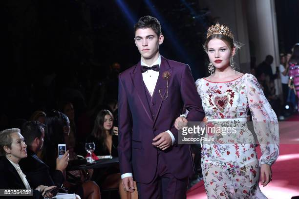 Hero FiennesTiffin and Laura Murray walk the runway at the Dolce Gabbana secret show during Milan Fashion Week Spring/Summer 2018 at Bar Martini on...