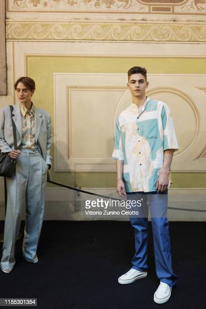 Hero FiennesTiffin poses during the Salvatore Ferragamo backstage in Piazza della Signoria during Pitti Immagine Uomo 96 on June 11 2019 in Florence...