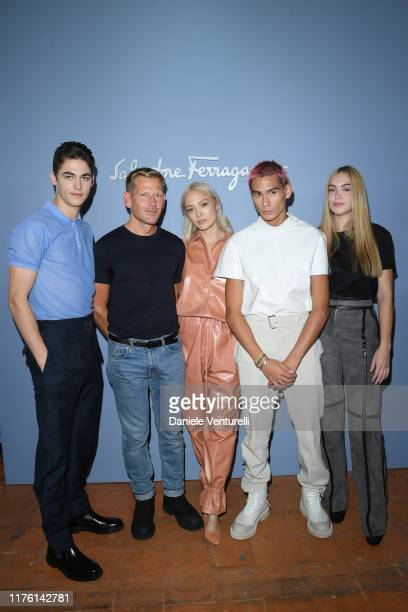 Hero FiennesTiffin The designer Paul Andrew Pom Klementieff Evan Mock and Mercy FiennesTiffin attend the Salvatore Ferragamo show during Milan...