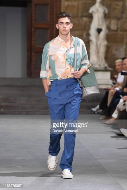 Hero Fiennes-Tiffin walks the runway at the Salvatore Ferragamo show in Piazza della Signoria during Pitti Immagine Uomo 96 on June 11, 2019 in...