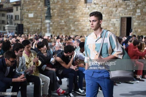 Hero Fiennes-Tiffin walks the runway at the Salvatore Ferragamo fashion show in Piazza della Signoria during Pitti Immagine Uomo 96 on June 11, 2019...