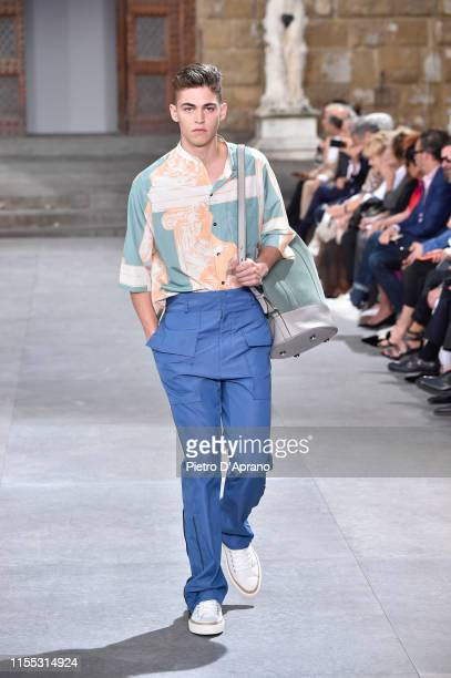 Hero FiennesTiffin walks the runway at the Salvatore Ferragamo fashion show in Piazza della Signoria during Pitti Immagine Uomo 96 on June 11 2019 in...